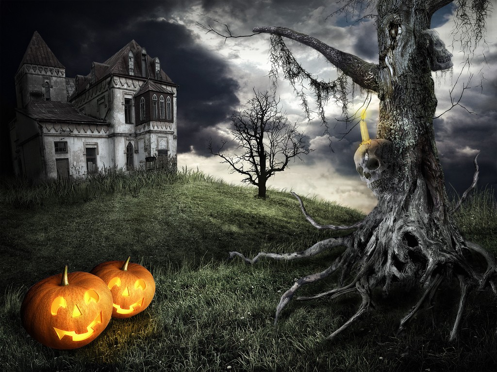 Mystical tree on the background of an abandoned house with orange pumpkins